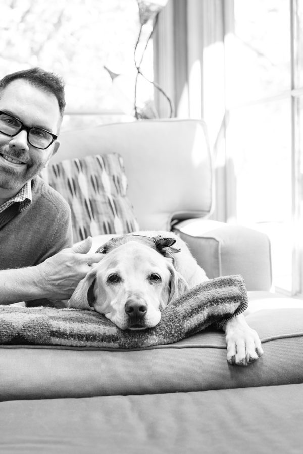 Gay Santa Fe Realtor Mark Banham with his dog at home